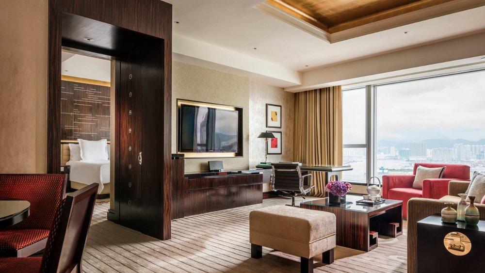 The rich warmth of timber-paneled corridors opens out into two different typical guest room schemes furnished in soothing palettes of wild plum and ivory.