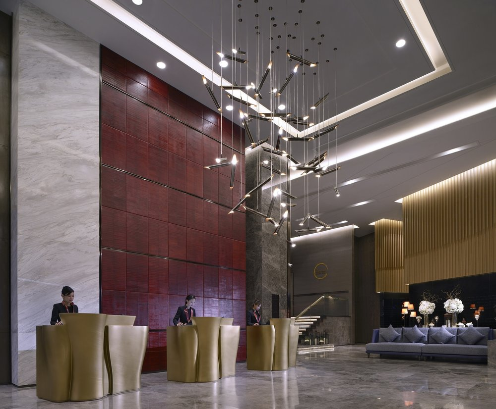 The lobby  is the main social hub—designed as sculptural elements anchored by cascading light sculptures, an abstract expression of the constant rain in Kuala Lumpur with the legends of local folklore inscribed into the transparent pieces.