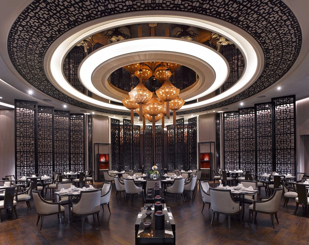 The unique Chinese restaurant's circular form mimics the Tulou architectural form, creating a focal communal dining theater, with private dining rooms and other functions radiating from this central circular form.
