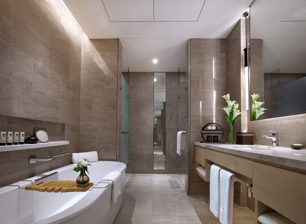 The bathroom is modern, impactful and is accentuated by an iconic free-standing bathtub with a rich bookmatched Italian marble wall.