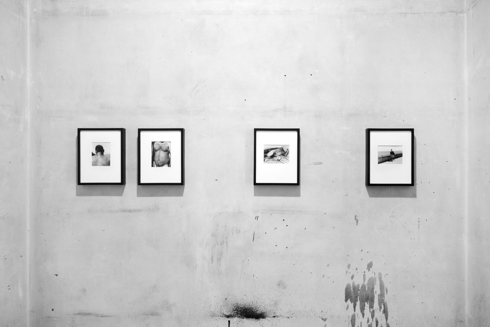 """Installation view. L to R:  """"Mountains"""",   """"River"""", """"Reclining nude"""", """"Sea.""""  All works over-matted, silver gelatin prints in 8.5x11in.painted wood frame."""