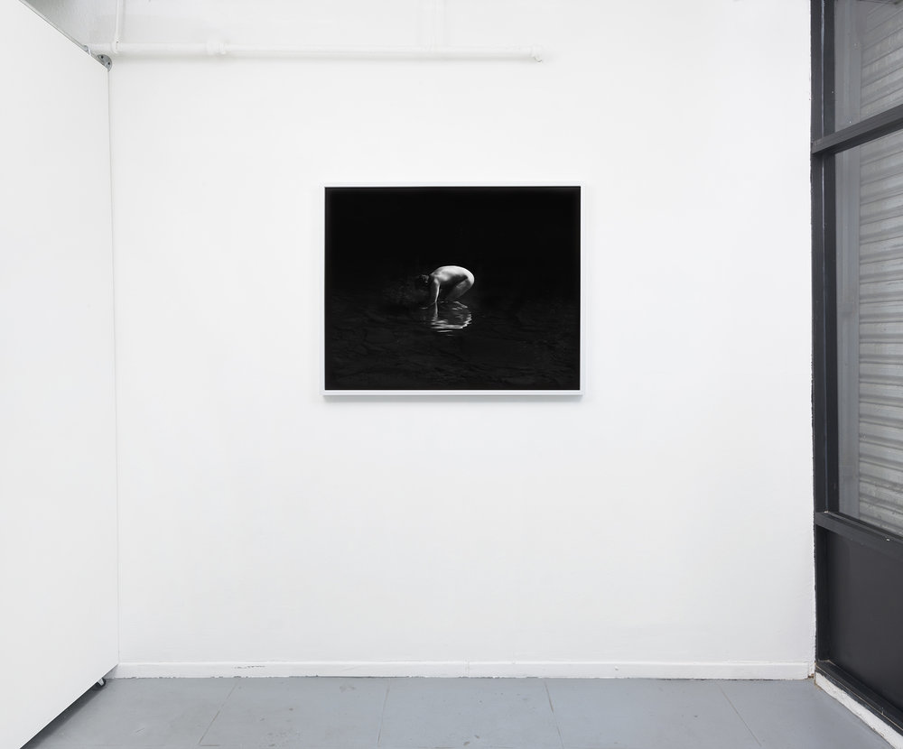 Installation view. .. .if water forgets how to play mirror, 32 x 40, silver gelatin print in painted wood frame,2018.