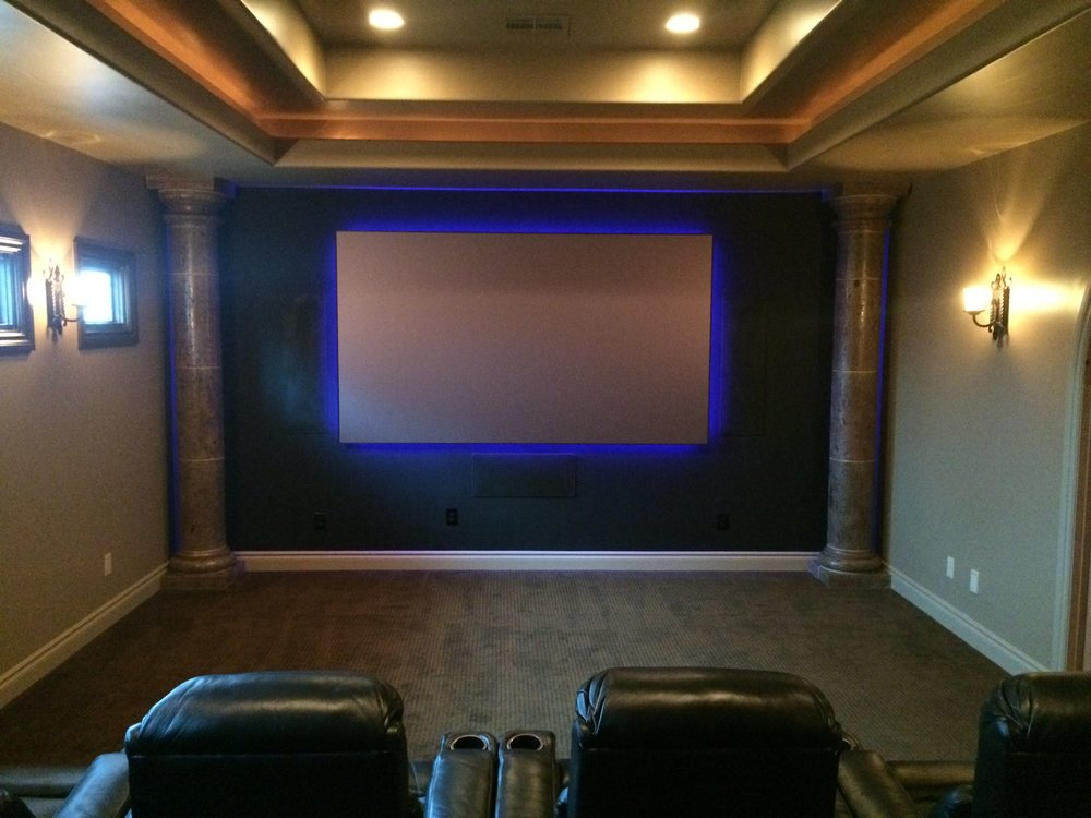 "120"" Ambient light rejecting screen, 7.2 surround sound system, custom equipment rack, multi-zone lighting control, 8 black leather reclining theater seats, full HD projector and integrated control system."
