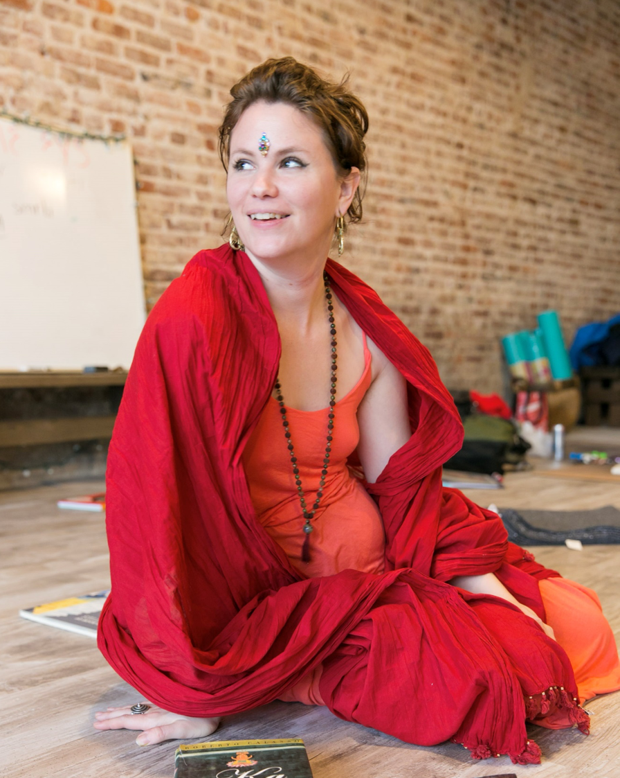 Libby CoxPhilosophy teacher - Libby Cox is an E-RYT 500, a mother of twin boys, an educator and a dedicated student of the body. With degrees in art, dance and education, a 19-year yoga practice, and a penchant for storytelling, Libby's teaching approach is compassionate, and witty.Teaching yoga since 2004, Libby has served on faculty in yoga teacher training programs in the US and abroad since 2010, drawing upon her studies from numerous styles of yoga and teaching approaches in order to meet the needs of yoga students and aspiring teachers alike. Most notable are Libby's studies with Patty Townsend, Judith Lasater, and Douglas Brooks.Townsend developed 'Embodyoga', an approach to movement steeped in anatomy-driven, developmental movement principles of Body Mind Centering (BMC). Libby uses these principles to help students discover and release underlying causes of dysfunctional movement patterns. Libby's studies with Judith Lasater have given her the skills to work individually with students on shoulder, hip and lower back health. Dr. Douglas Brooks introduced her to Rajanaka Tantra, a body of ideas that emphasize the invaluable education of everyday human experience. Libby works with students, using the vision of yoga philosophy, to help them gain perspective, presence and resilience through life's joys and challenges. Libby recognizes that to be a knowledgeable instructor one has to understand the world of yoga as a whole and not be closed off to any yoga experience, knowledge or practice. It is through this knowledge, Libby discovered, she stays grounded in her personal practice.his combination of studies has sustained Libby's long time love of connecting the exploration of body-mind and breath to invigorating, well-informed creative movement. She also loves the support and inspiration that grows out of being part of a yoga community, and seeks to share her love of yoga as a philosophy that nourishes the capacity for creativity and resilience on life's paths.A r
