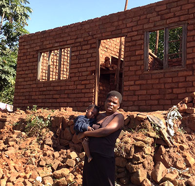 37 homes of our gogos were destroyed by the historic cyclone and flooding. Bricks had to be made and the remaining maize harvested before rebuilding could begin. Mervis, pictured in front of her almost finished home, lived in a classroom at our CBCC in Simiyoni village until she could move in. It was the outpouring of help from the gogos and sponsors in the U.S. that made the recovery a tribute to God's mercy and grace.