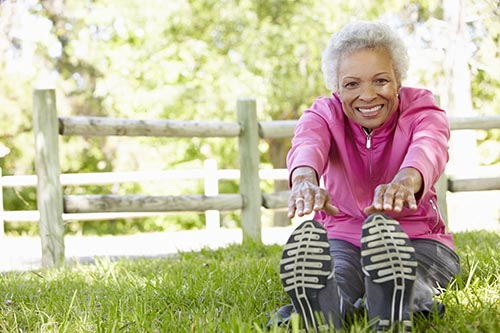 senior-african-american-woman-exercising-in-park