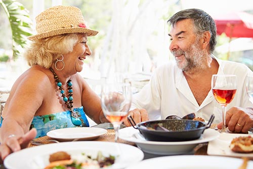senior-couple-enjoying-meal-in-outdoor-restaurant