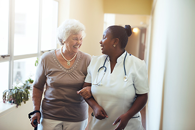 Nurse and Senior Woman Walking
