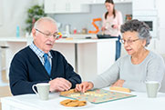 Senior-couple-playing-board-game