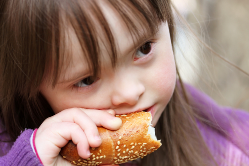 Portrait of beautiful girl eating baguette