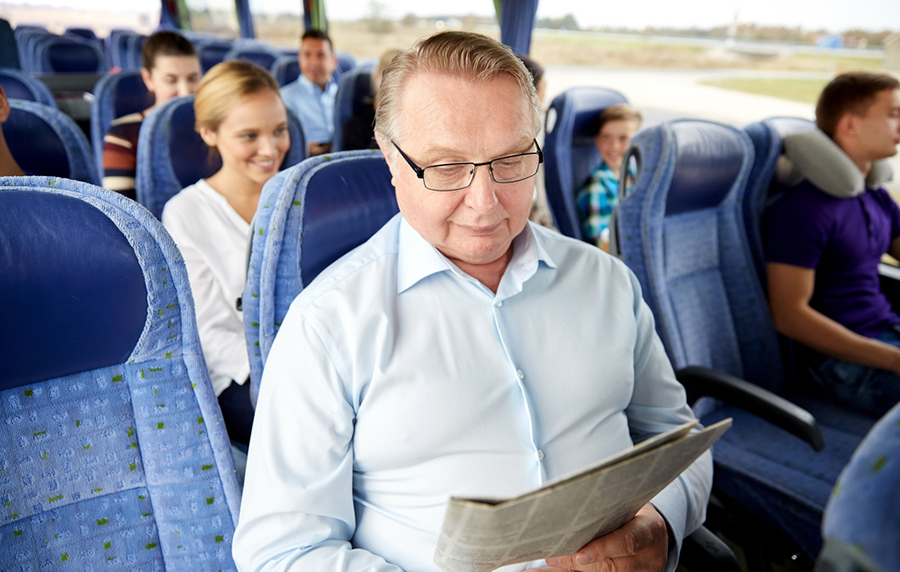 man reading on bus