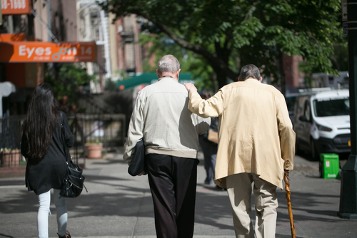 two elderly men walking