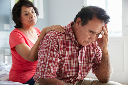 wife comforting senior husband dementia