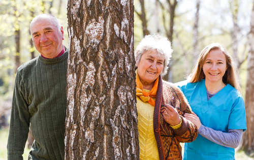 elderly couple caregiver outdoors