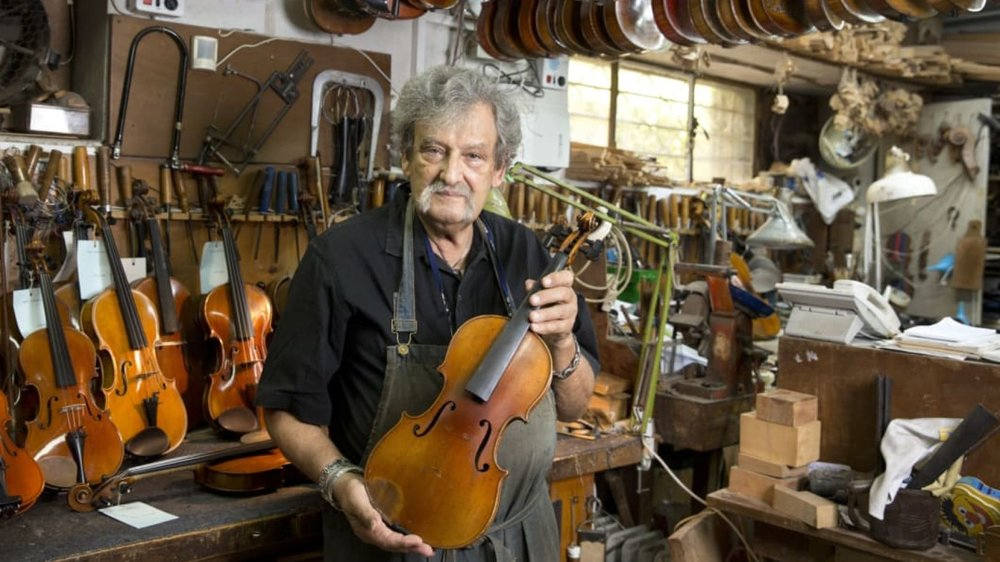 Amnon Weinstein, the driving force behind Violins of Hope, with the violin that belonged to Fanny Hecht. Credit: Moti Milrod