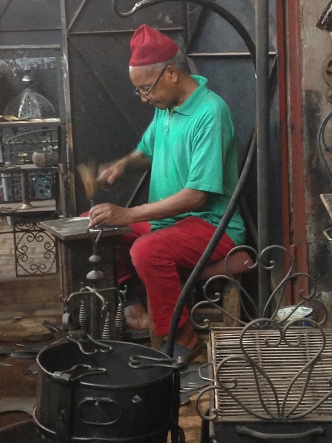 An artisan in balanced posture in Marrakesh. Jean Couch photo.