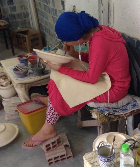A new generation of artisan with a new and not so artful posture. Jean Couch photo.