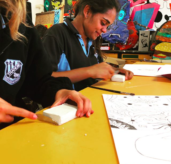 Students creating their own stamp designs at a recent Carved Up workshop in Trangie.