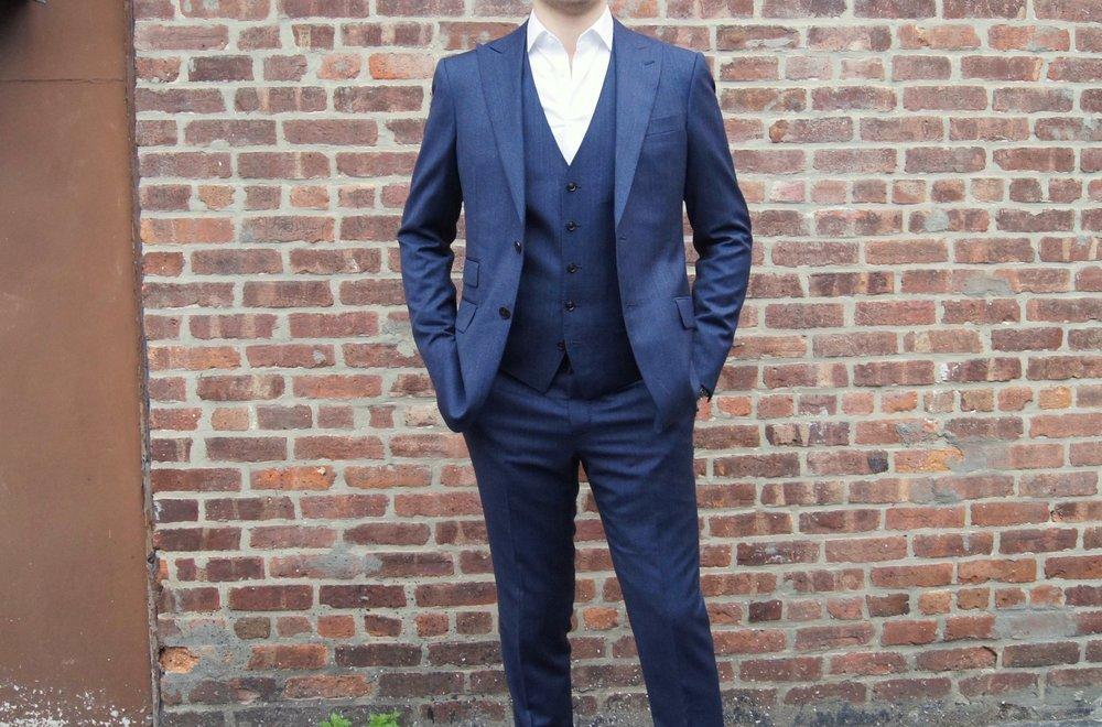 A Black Lapel MTM suit