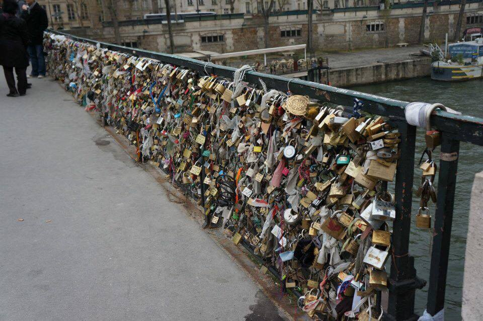 Love locks on Pont des Arts over Siene River in Paris