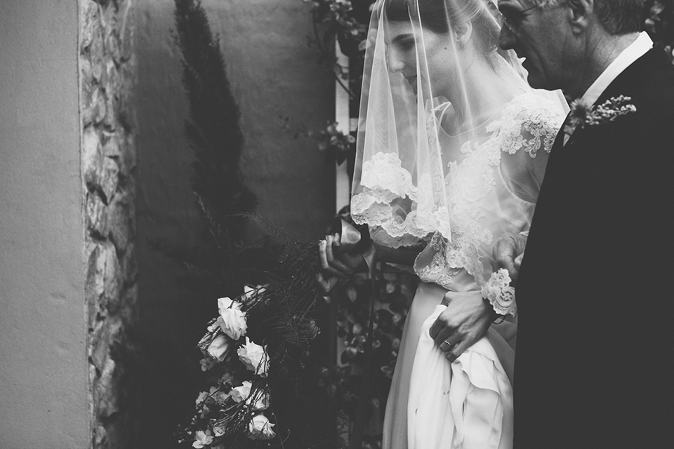 Caitlin's veil had a lace trim that was used as a trim on her mother's actual wedding dress. Photo: He Is Visual