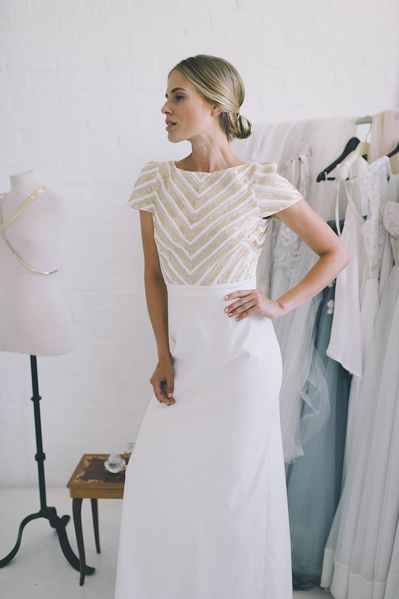 Oriana - Crepe dress with custom geometric hand-beading in a column silhouette with diamond open back.Size 10SALE PRICE: R20 000