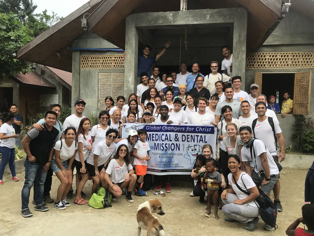 Under the rooftop of an outdoor community center, our family team provided free care for over 250 medical and dental patients and at the same time constructed improvements for the local Ati School nearby.