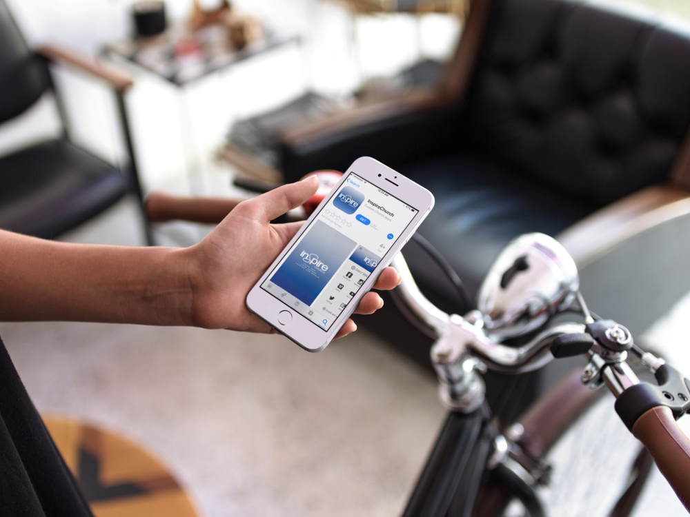 white-iphone-6s-mockup-held-by-a-man-about-to-go-on-a-bicycle-ride-12964.png