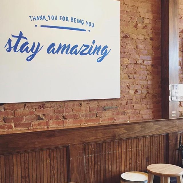 For #NationalSelfieDay, stop in, grab a latte and snap a photo in front of our #stayamazing wall as a reminder to keep being you 👌 📸: @chelseyshockley