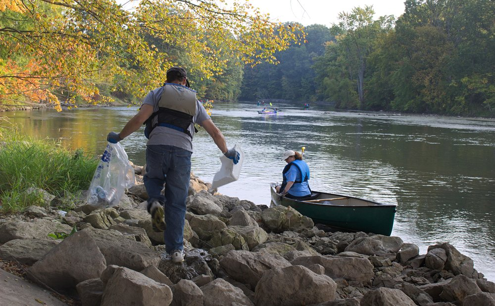 Sonday and Werdon fell behind the group before they even crossed under the 84th Street bridge, but had already gathered plenty of refuse, as well. Werdon often held the canoe in place while Sonday jumped ashore, or into the river, to gather cast-off bottles and bags.