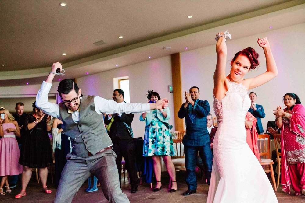 A bride and groom doing their first dance on a Nintendo Wii