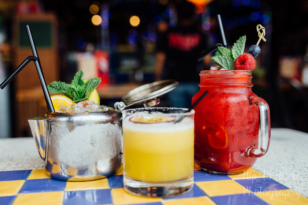 Three cocktails on a table
