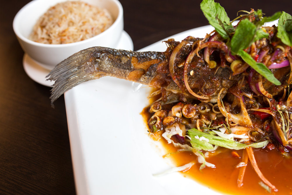 A fish's tail on a plate of Thai food