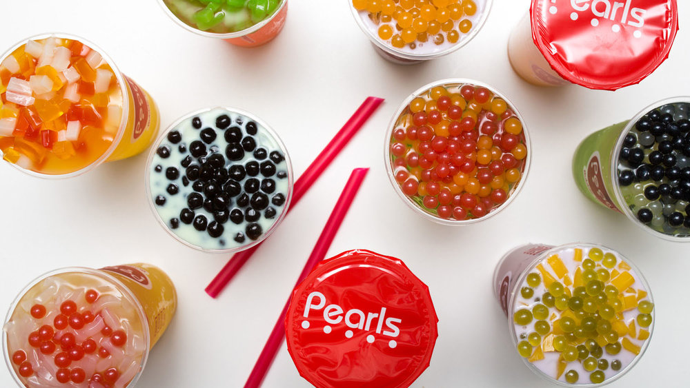 An aerial shot of several cups of Pearl's Bubble Tea