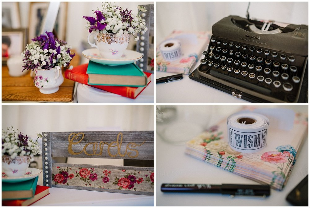 a vintage typewriter and flowers in teacups at a wedding reception