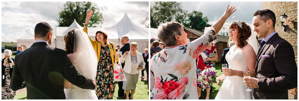 guests throwing confetti over a bride and groom at a yorkshire wedding
