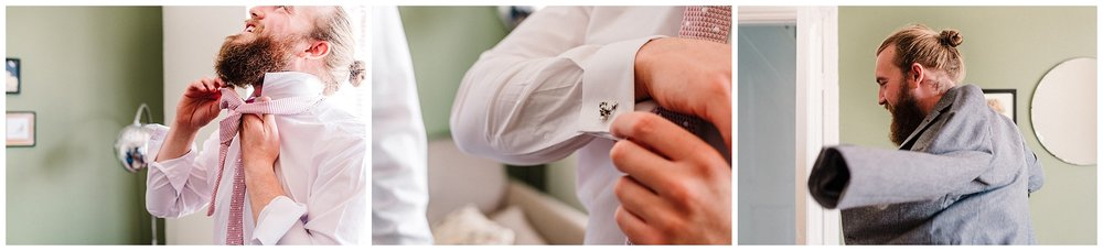 a groom putting his tie and cufflinks on