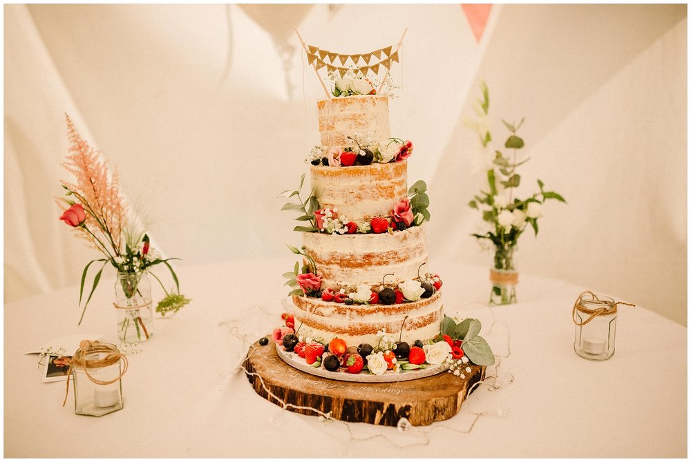 a naked wedding cake on a table at a yorkshire wedding
