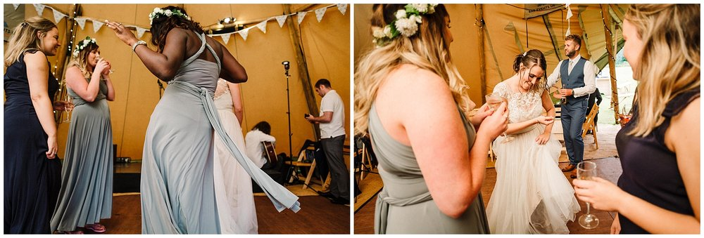 a bride dancing with her bridesmaids at a yorkshire tipi wedding