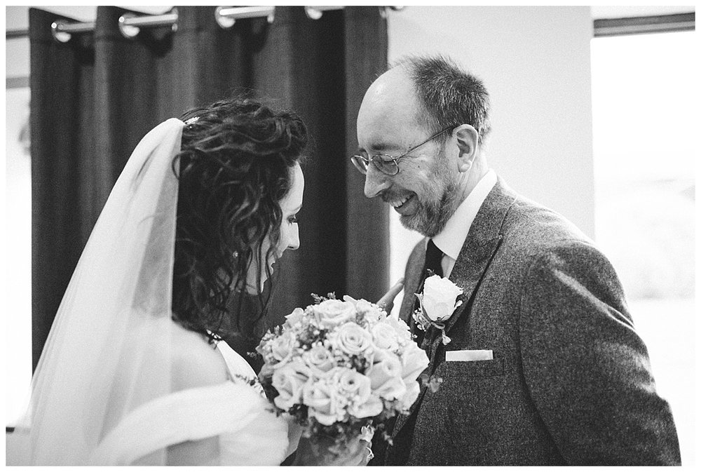 a bride and her dad having a quiet moment at a barn wedding