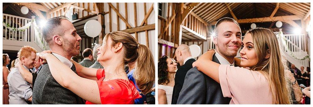 guests dancing at a barn wedding