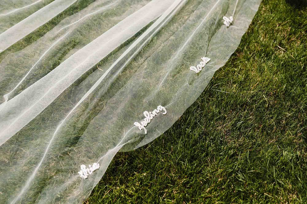 an embroidered veil on grass