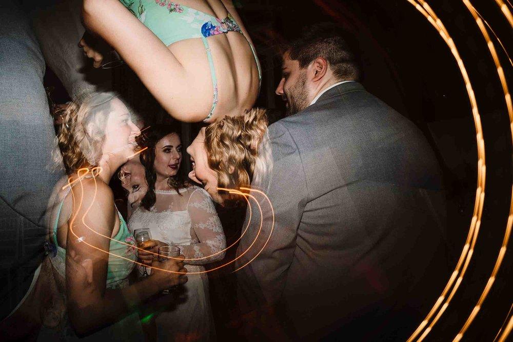 bride and friends on the wedding dance floor