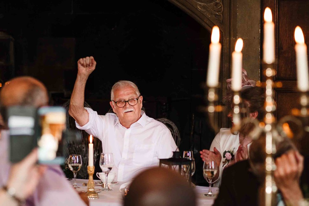 The bride's grandad punching the air during speeches