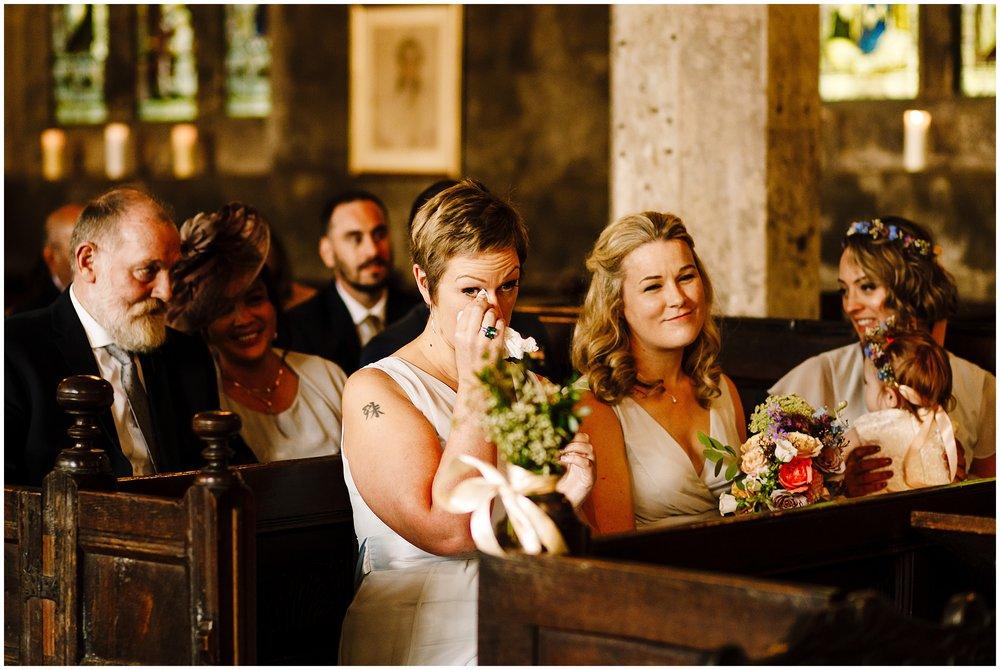 A bridesmaid crying