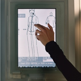 Prada's interactive touch screen that allowed customers to select alternative sizes, colours, fabrics and styles or see the garment worn on the Prada catwalk.