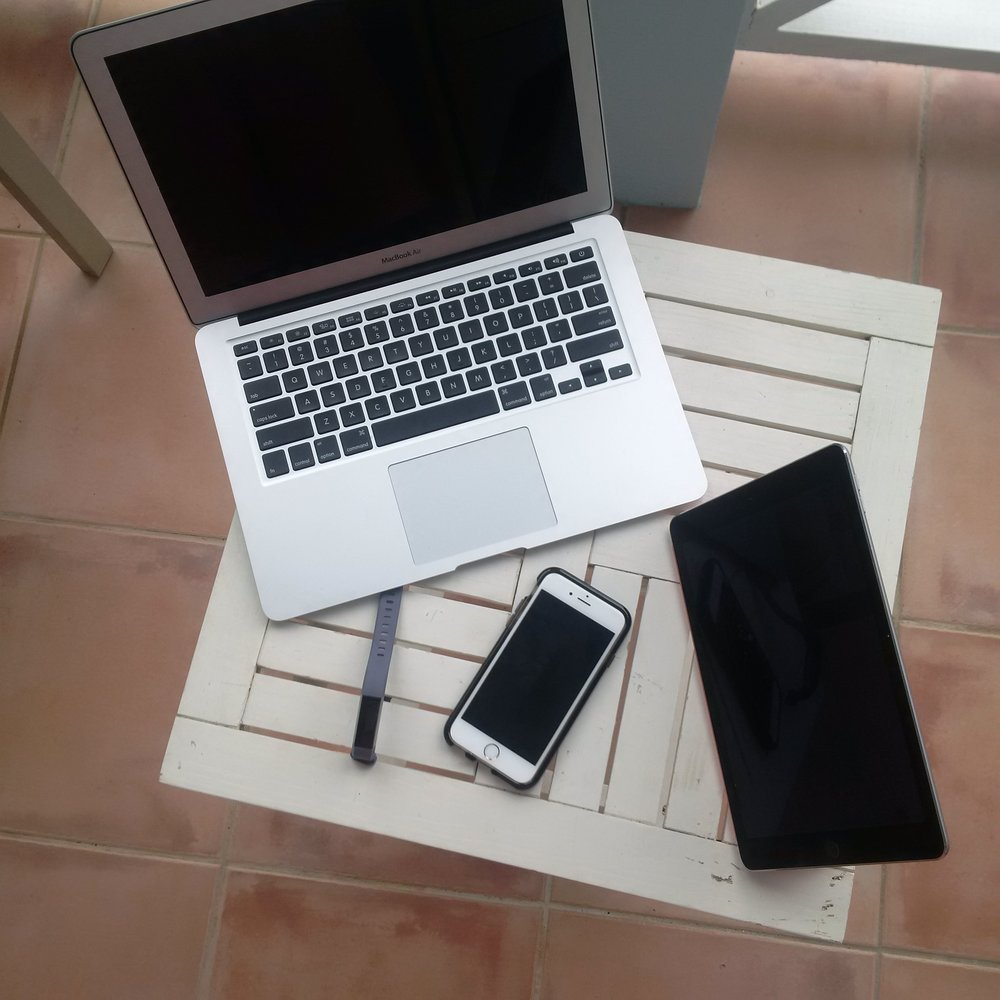 My laptop, tablet, smart phone and Fitbit.