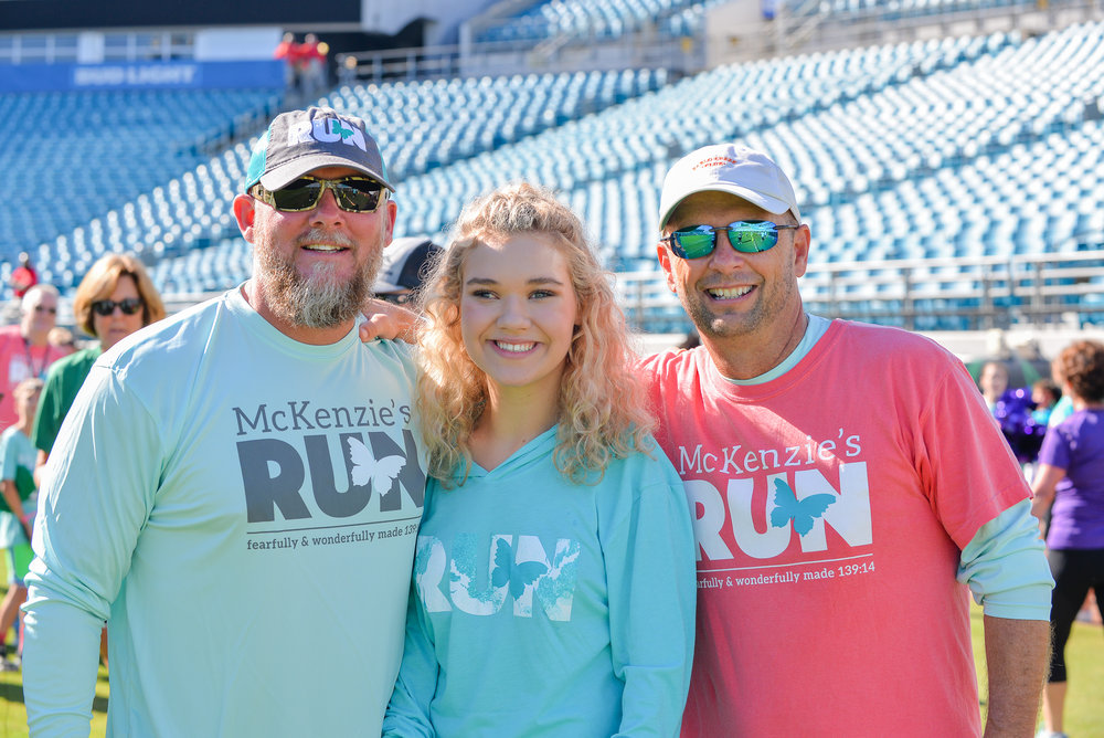 2017 McKenzie's Run Captain, Rion Paige (center), with Pastor Joby Martin of The Church of Eleven22 (left) and Mr. Blake Wilson, McKenzie's Father and CEO of The McKenzie Noelle Wilson Foundation (right).