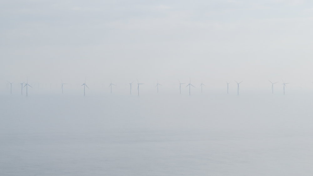 Wind Turbines out in the Sea Mist