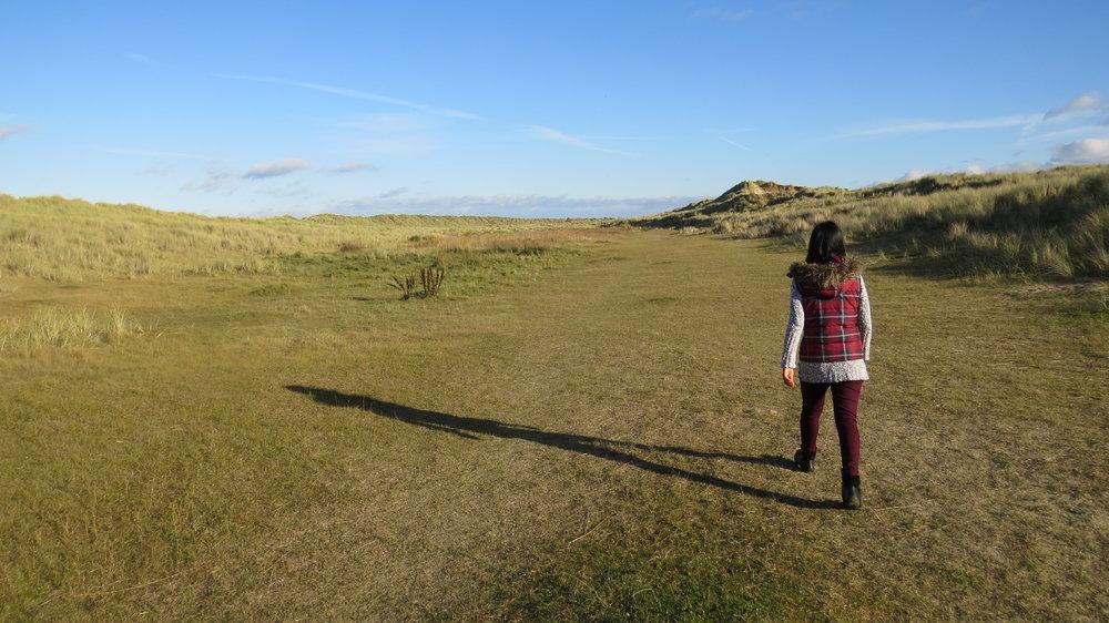 Priya walking through the Dunes
